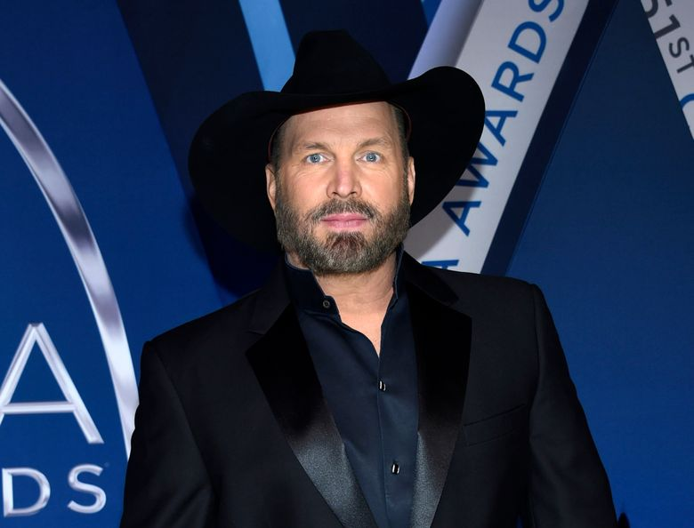 """FILE – This Nov. 8, 2017 file photo shows Garth Brooks at the 51st annual CMA Awards in Nashville, Tenn. Brooks, whose hits include """"Friends in Low Places,"""" and """"The Thunder Rolls,"""" will receive the Library of Congress Gershwin Prize for Popular Song in March 2020. (Photo by Evan Agostini/Invision/AP, File)"""