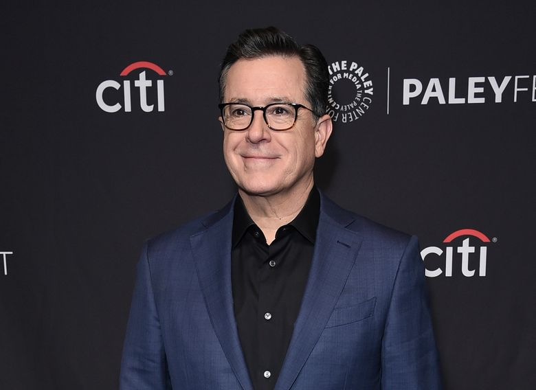 """FILE – This March 16, 2019 file photo shows Stephen Colbert at the 36th Annual PaleyFest """"An Evening with Stephen Colbert"""" event in Los Angeles. CBS announced Thursday that Colbert has signed a new contract that will keep him as the """"Late Show"""" host through at least August 2023. His current pact was set to expire next August. (Photo by Richard Shotwell/Invision/AP, File)"""