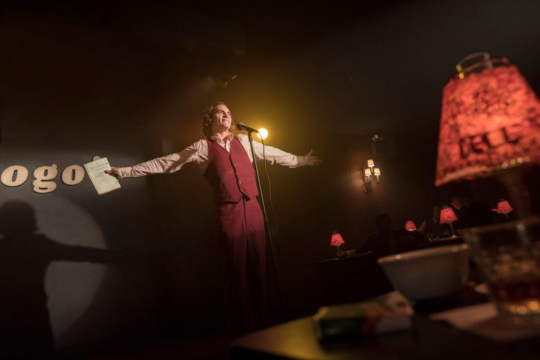 """This image released by Warner Bros. Pictures shows Joaquin Phoenix in a scene from """"Joker,"""" in theaters on Oct. 4.  (Niko Tavernise/Warner Bros. Pictures via AP)"""