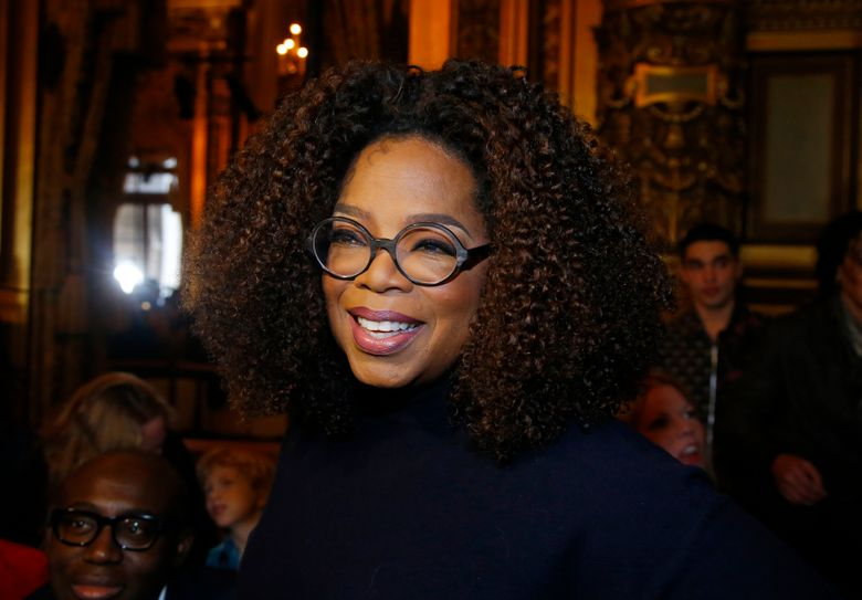 FILE – This March 4, 2019 file photo shows Oprah Winfrey at the presentation of Stella McCartney's ready-to-wear Fall-Winter 2019-2020 fashion collection in Paris. Winfrey says she's giving $13 million to increase a scholarship endowment at Morehouse College in Atlanta, a historically black college. (AP Photo/Michel Euler, File)