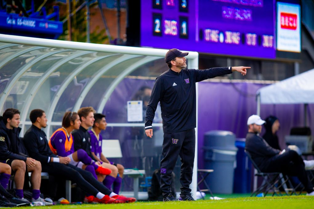 UW men's soccer coach Jamie Clark calls out to his players as his team defeats Oregon State 2-1 on Oct. 13, 2019. (Scott Eklund /Red Box Pictures)