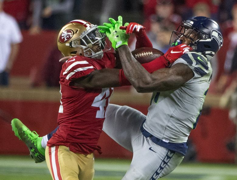 Seahawks wide receiver DK Metcalf and San Francisco 49ers defensive back Emmanuel Moseley battle for the ball Nov. 11. (Mike Siegel / The Seattle Times)