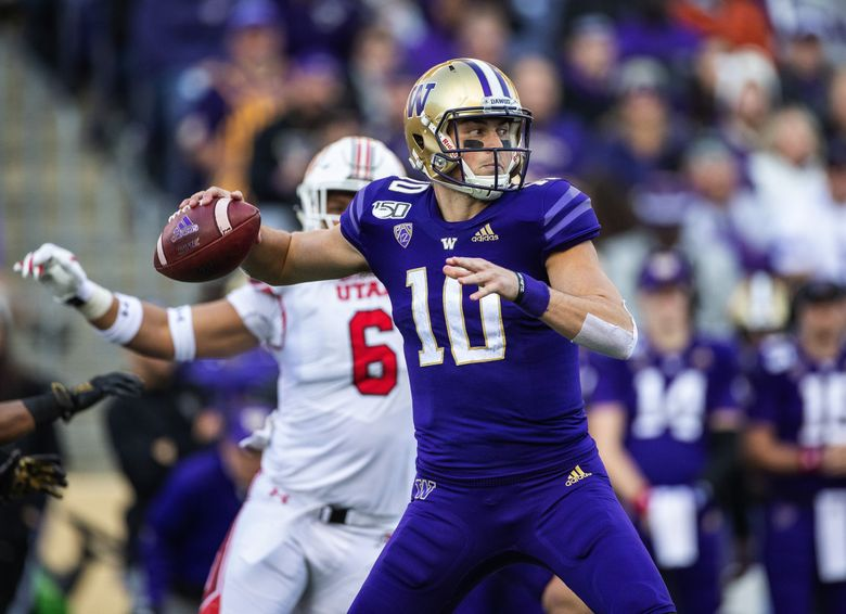 Jacob Eason finished 29-52 with 2 interceptions, 316 yards and four touchdowns on Saturday vs. Utah. (Dean Rutz / The Seattle Times)