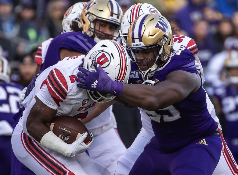 Washington's Levi Onwuzurike gets to Utah running back Zach Moss and drops him for a 4-yard loss in the 3rd quarter.  The 9th-ranked Utah Utes played the Washington Huskies in Pac-12 football Saturday, November 2, 2019 at Husky Stadium in Seattle, WA. (Dean Rutz / The Seattle Times)