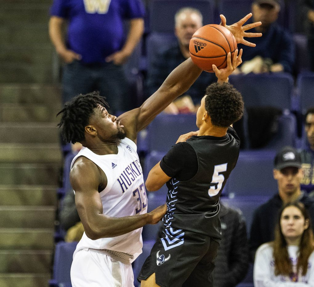 Western guard D'Angelo Minnis (5) has no chance against the reach of Washington's Isaiah Stewart in the first half against Western Washington University Vikings on Thursday, October 31, 2019 at Alaska Airlines Arena.  (Dean Rutz / The Seattle Times)