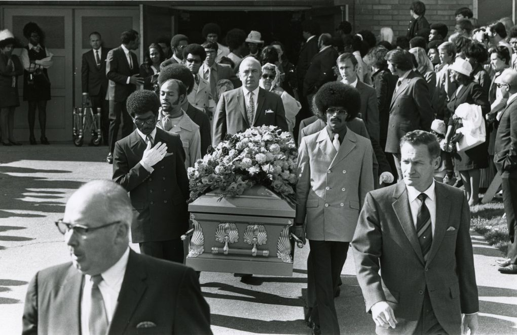 Jimi Hendrix's casket is carried from the Dunlap Baptist Church after his funeral in 1970. The pallbearers included Herb Price, left, Hendrix's valet; Donny Howell, a childhood friend, behind Price; and Eddie Rye, another friend, right. Behind the casket is Bernard Freeley, a funeral-home manager. (Pete Liddell / The Seattle Times)