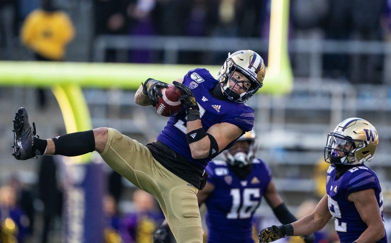 Washington's Elijah Molden comes down with the interception of WSU quarterback Anthony Gordon in the first quarter.  (Dean Rutz / The Seattle Times)