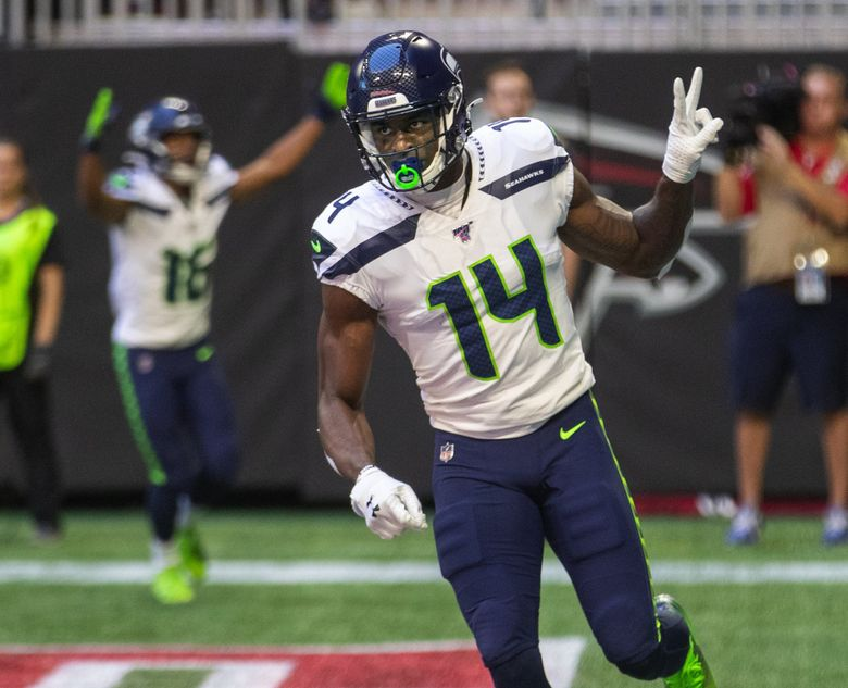 Seattle Seahawks wide receiver DK Metcalf (14) celebrates the first of his two touchdown catches against the Atlanta Falcons at Mercedes-Benz Stadium on October 27, 2019.  (Mike Siegel / The Seattle Times)