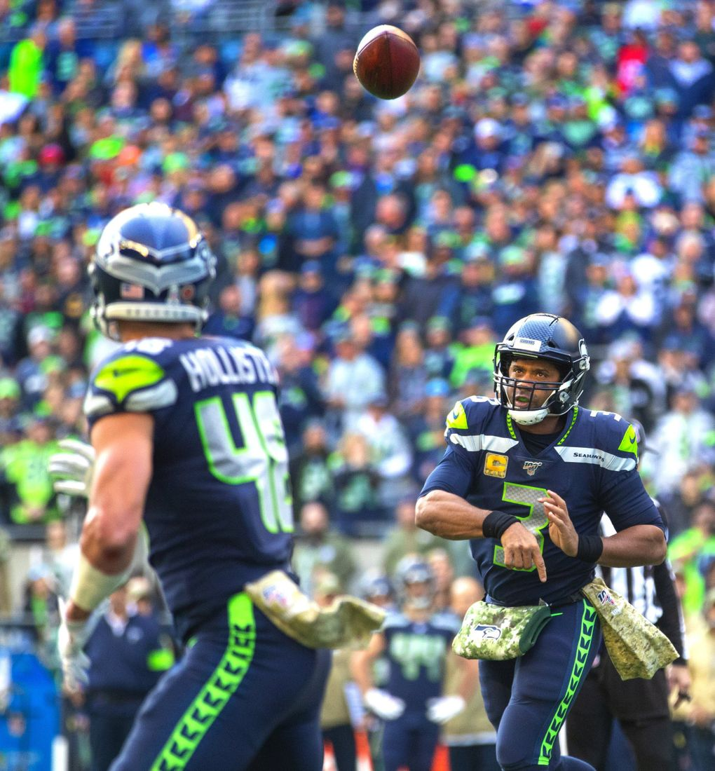 Seattle Seahawks quarterback Russell Wilson (3) lobs a pass to Seattle Seahawks tight end Jacob Hollister (48) as the Seattle Seahawks take on the Tampa Bay Buccaneers at CenturyLink Field in Seattle Sunday November 3, 2019.  (Mike Siegel / The Seattle Times)