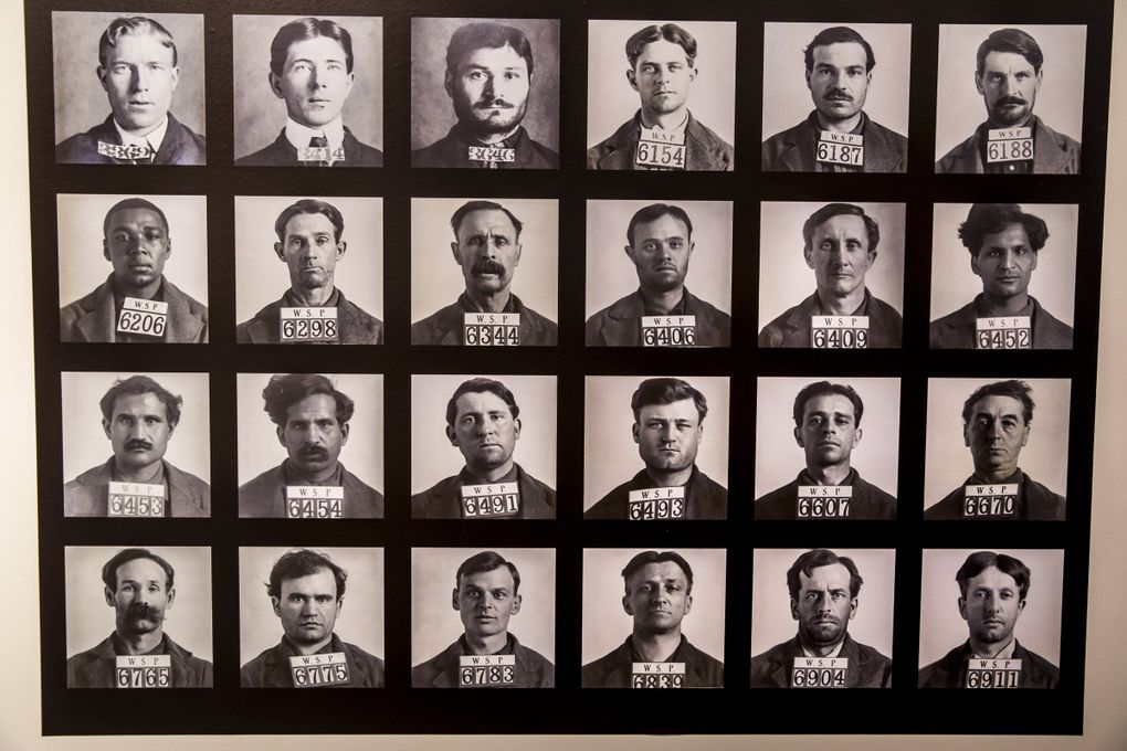"""Photography historian David Chapman and his partner, Dave Berryman, compiled this collection of mugshots showing gay men arrested, booked and convicted of sodomy between 1893 to 1913. This collection is on display at """"The Lavender Palette"""" at Cascadia Art Museum. (Bettina Hansen / The Seattle Times)"""