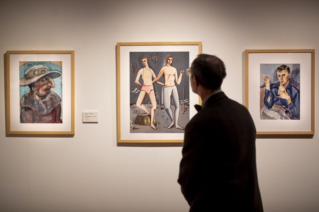 """A member of Mature Friends, a social group for gay and lesbian individuals and same-sex couples, checks out Cascadia Art Museum's exhibition, """"The Lavender Palette."""" (Bettina Hansen / The Seattle Times)"""