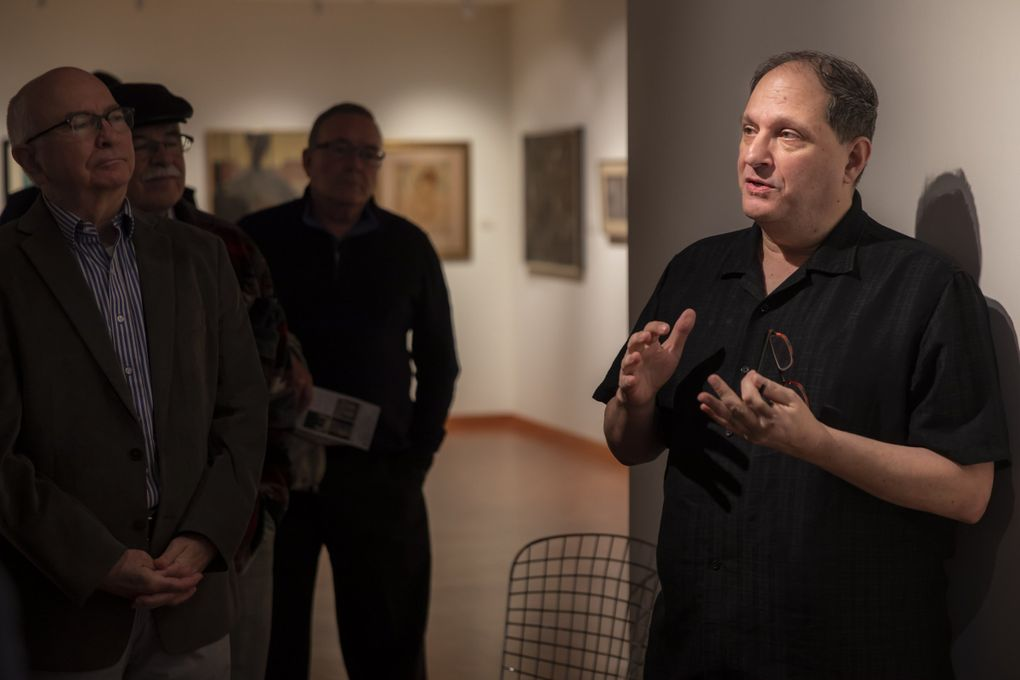 """""""Haven't we all had to be activists at some point in our lives,"""" curator David Martin says as he gives a tour of Cascadia Art Museum's exhibition, """"The Lavender Palette,"""" which features gay and lesbian artists from around the Pacific Northwest. (Bettina Hansen / The Seattle Times)"""