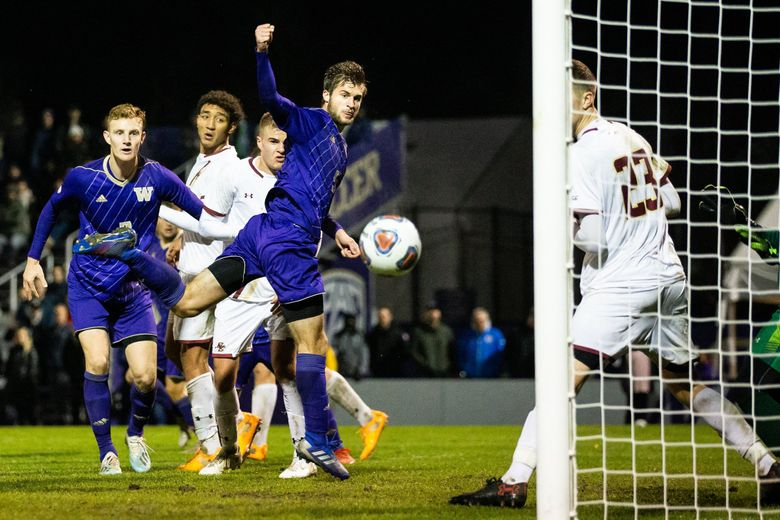 Ethan Bartlow (5) bounces a header off the crossbar as teammate Freddy Kleemann watches during the second half of the NCAA men's soccer playoff match between University of Washington and Boston College at UW on Nov. 24, 2019. The Huskies won 2-0.  (Andy Bao / The Seattle Times)