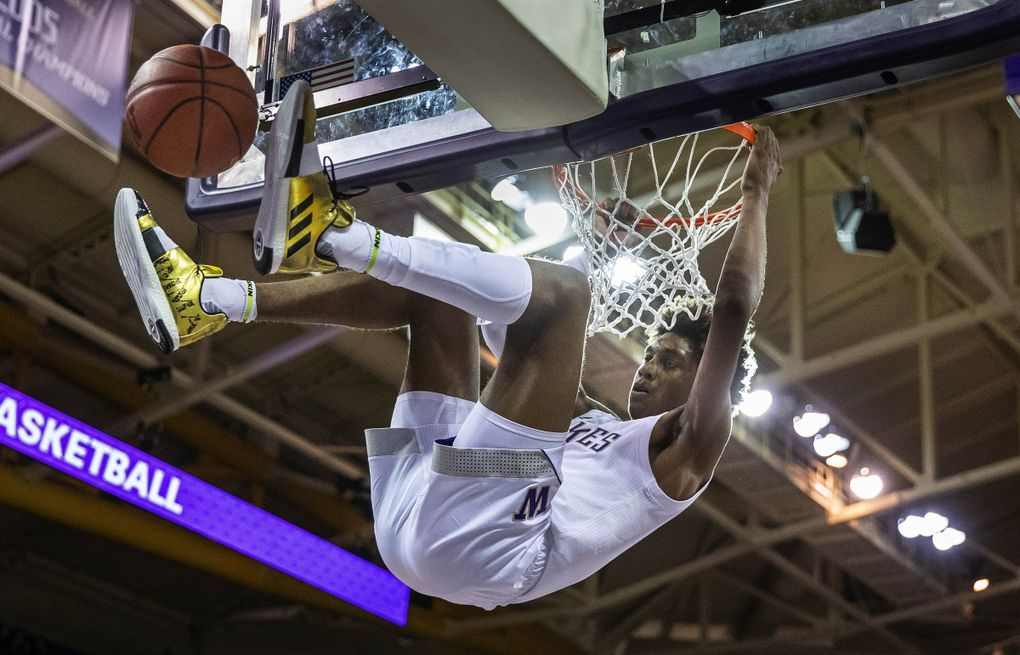 Jaden McDaniel's emphatic jam gave the Huskies a 43-23 lead over Western Washington on Thursday, October 31, 2019 at Alaska Airlines Arena. (Dean Rutz / The Seattle Times)