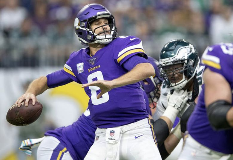Minnesota Vikings quarterback Kirk Cousins looks to throw against the Philadelphia Eagles at U.S. Bank Stadium in Minneapolis on October 13, 2019.