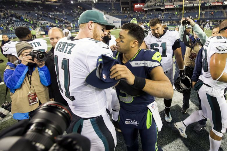Seahawks quarterback Russell Wilson greets Eagles quarterback Carson Wentz after the Seattle Seahawks defeated the Philadelphia Eagles 24-10 at CenturyLink Field in Seattle Sunday December 3, 2017. 204423 (Bettina Hansen / The Seattle Times)