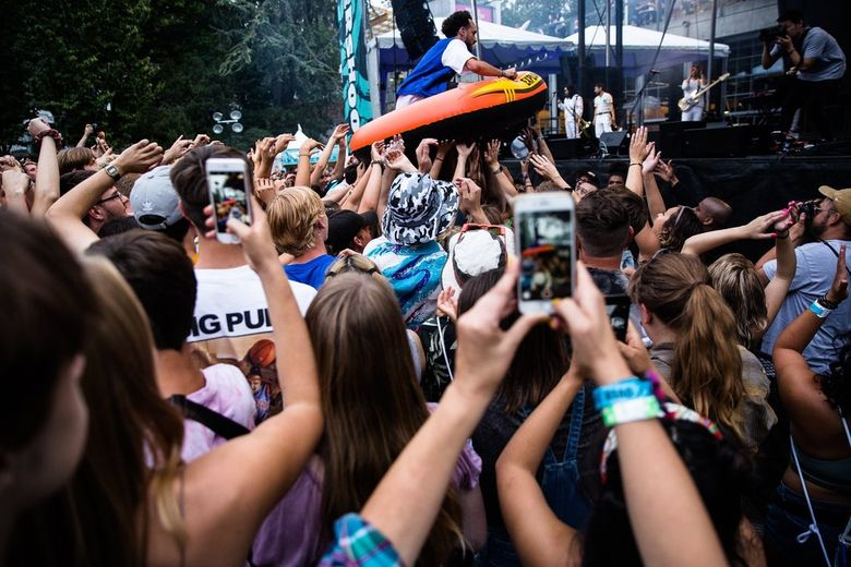 Bumbershoot 2019 featured musician Sol, who crowd surfed on a raft during his set. (Rebekah Welch / The Seattle Times)