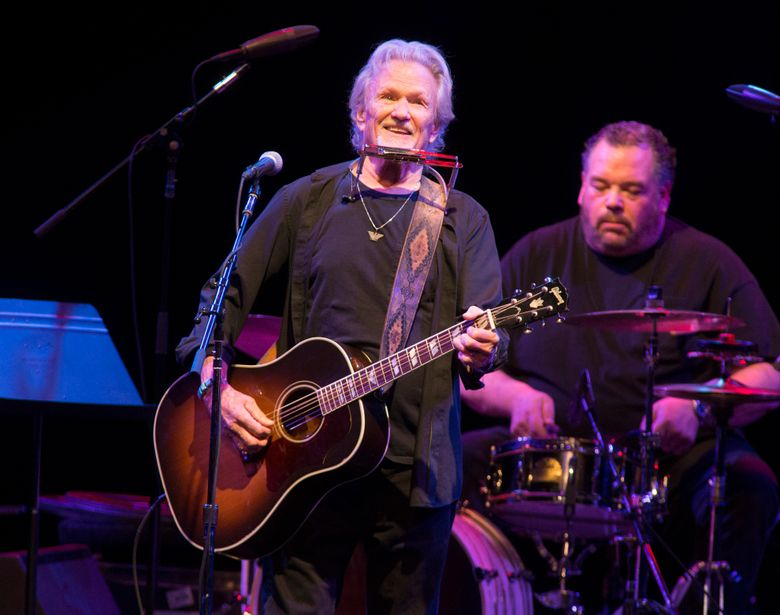 FILE – In this April 12, 2019, file photo, Kris Kristofferson performs in concert at The American Music Theatre in Lancaster, Pa. Kristofferson surprised customers when he performed with an acoustic guitar at a North Dakota bar after a band taped a request to the singer-songwriter's tour bus. Kristofferson stopped at Dempsey's Public House in downtown Fargo on Saturday night, Nov. 9, 2019, and asked to sing with the band 32 Below. (Photo by Owen Sweeney/Invision/AP, File)
