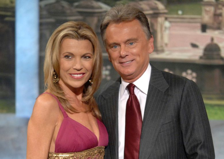 """FILE – In this Sept. 29, 2007 file photo, co-host Vanna White and host Pat Sajak make an appearance at Radio City Music Hall for a taping of celebrity week on """"Wheel of Fortune"""" in New York. Sajak had to have emergency surgery, and his longtime sidekick Vanna White is filling in as host while he recovers. The show says on its social media accounts that the Thursday. Nov. 7, 2019, taping was canceled as the 73-year-old Sajak underwent successful emergency surgery to correct a blocked intestine.  (AP Photo/Peter Kramer, file)"""