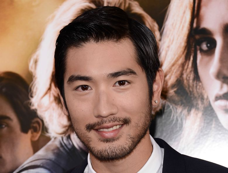 """FILE – In this August 12, 2013, file photo, actor Godfrey Gao arrives at the world premiere of """"The Mortal Instruments: City of Bones"""" at the ArcLight Cinerama Dome in Los Angeles. Gao has passed away while on set from an apparent heart attack. The 35-year-old Gao has passed away while on set from an apparent heart attack. Gao had been while filming a sports reality show in the eastern Chinese city of Ningbo on Wednesday when he died. His agency, JetStar Entertainment, confirmed his death on its official Facebook page. (Photo by Dan Steinberg/Invision/AP)"""