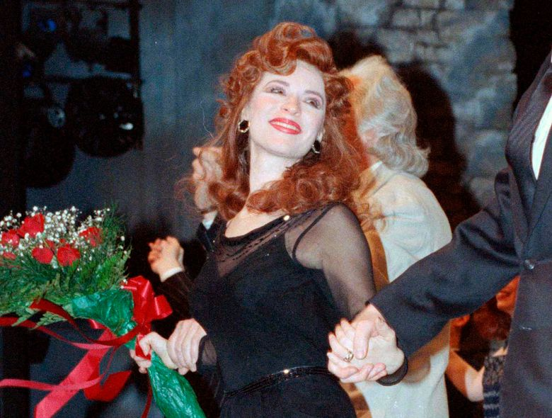 """FILE – This April 9, 1990 file photo shows actress Ann Crumb at the curtain call for the Andrew Lloyd Webber musical """"Aspects of Love"""" on opening night in New York. Crumb, a Tony Award-nominated actress who originated the role of Rose Vibert in """"Aspects of Love,"""" died, Thursday, Oct. 31, 2019 from ovarian cancer at her parent's home in Media, Pa. She was 69. (AP Photo/Ed Bailey, File)"""
