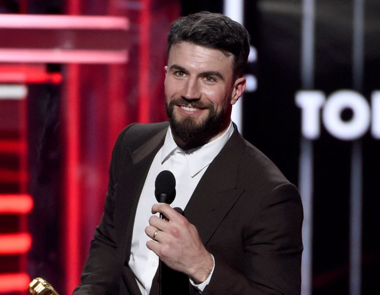 """FILE – This May 20, 2018 file photo shows Sam Hunt accepting the award for top country song for """"Body Like A Back Road"""" at the Billboard Music Awards in Las Vegas. Hunt was arrested for driving under the influence and violation of the open container law after police in Nashville stopped him for driving the wrong way down a one-way road. Hunt was arrested Thursday morning about 6:30 a.m., booked into jail and released from jail on a $2,500 bond, according to WKRN-TV. (Photo by Chris Pizzello/Invision/AP, File)"""