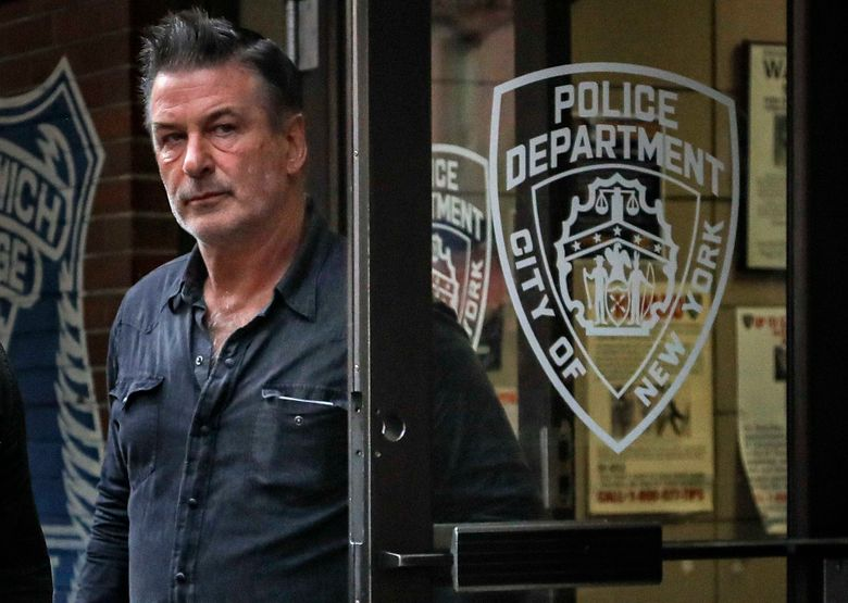FILE – This Friday, Nov. 2, 2018, file photo shows actor Alec Baldwin leaving New York Police Department's 10th Precinct, after his arrest for allegedly punching a man in the face over a parking spot. Baldwin filed a defamation lawsuit Friday, Nov. 1, 2019, against the man who says Baldwin hit him in the face during an argument over the parking space. (AP Photo/Julie Jacobson, File)