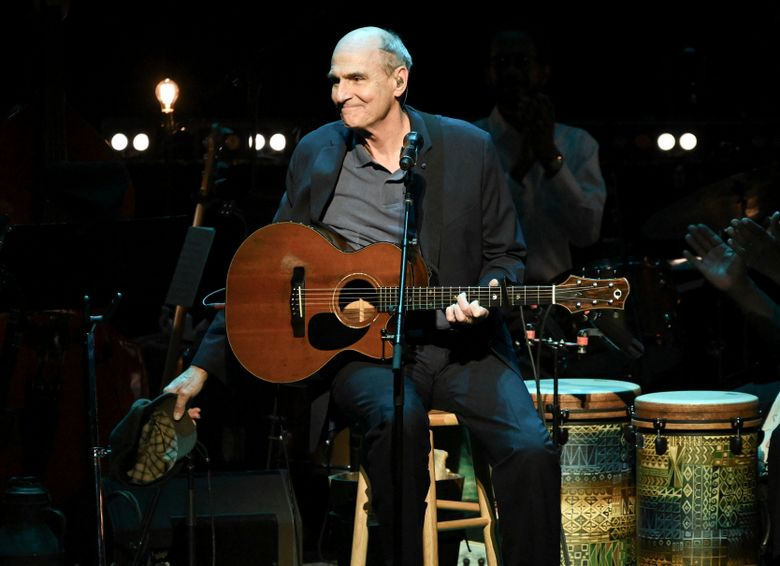 """FILE – This Nov. 7, 2018 file photo shows James Taylor performing at JONI 75: A Birthday Celebration in Los Angeles. Taylor has a deal with the producer-distributor Audible for the audio-only """"Break Shot,"""" focusing on his early years and end on """"the cusp"""" of his 1970s fame. Scheduled for early 2020, the book features an interview with journalist Bill Flanagan and highlights from his music. (Photo by Richard Shotwell/Invision/AP, File)"""