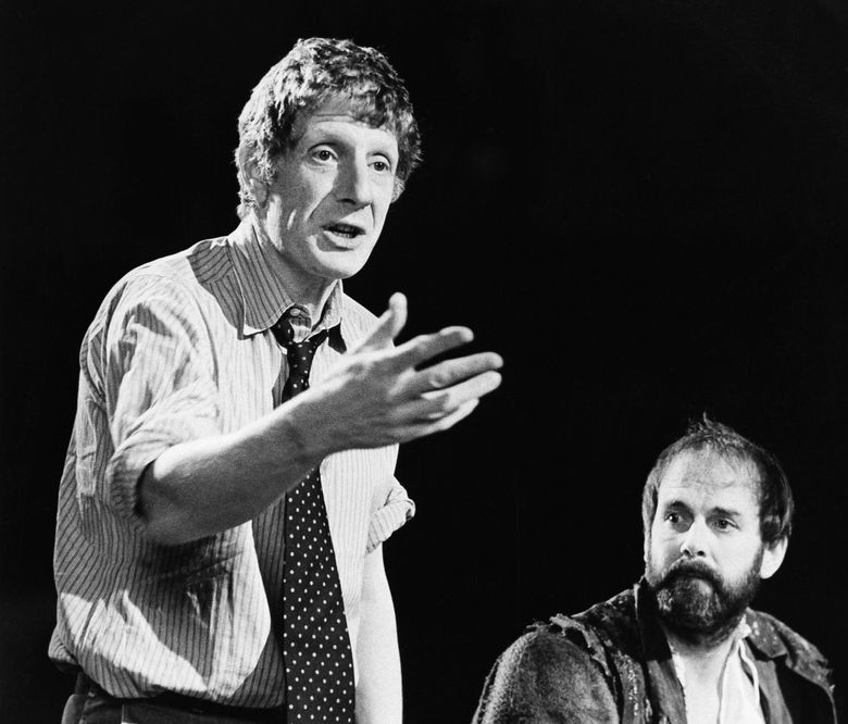 """FILE – In this Dec. 12, 1980 file photo, Jonathan Miller, left, directs Shakespeare's """"Taming Of The Shrew"""" with actor John Cleese, right. The family of theater director and presenter Jonathan Miller says the star of the """"Beyond the Fringe'' comedy revue has died. He was 85 and had suffered from Alzheimer's disease before his death Wednesday Nov. 27, 2019. (AP Photo, File)"""