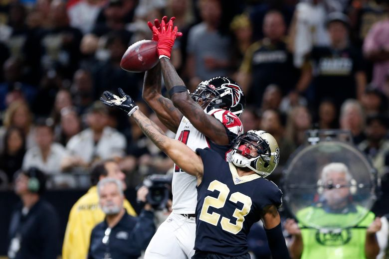 Atlanta Falcons wide receiver Julio Jones (11) tries in vain to pull in a pass in the end zone over New Orleans Saints cornerback Marshon Lattimore (23) in the first half of an NFL football game in New Orleans, Sunday, Nov. 10, 2019. (AP Photo/Rusty Costanza)