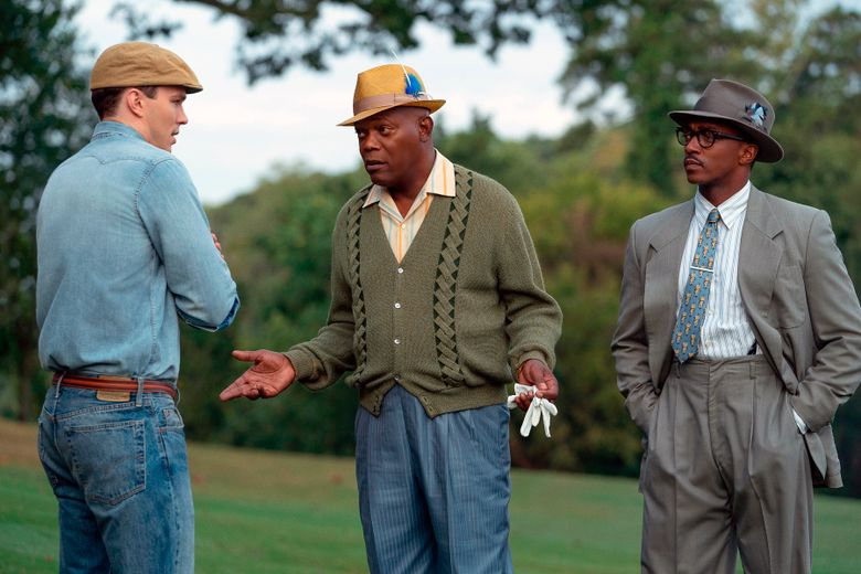"""This image released by Apple TV Plus shows, from left, Nicholas Hoult, Samuel L. Jackson and Anthony Mackie in a scene from """"The Banker."""" Apple has canceled the premiere of one of the tech company's first original films, """"The Banker"""" the day before it was to debut at Los Angeles' AFI Film Festival.  In a statement Wednesday, Apple said that it learned of """"some concerns"""" surrounding """"The Banker"""" and that it needs """"some time to look into these matters."""" An Apple spokesperson declined to elaborate.  (Apple TV Plus via AP)"""