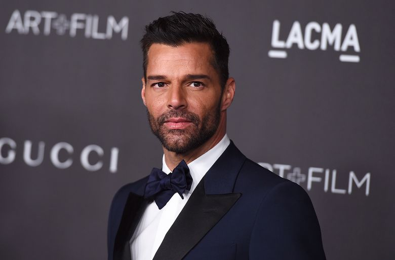 """FILE – This Nov. 2, 2019 file photo shows Ricky Martin at the 2019 LACMA Art and Film Gala in Los Angeles. Martin will perform his latest song """"Cántalo"""" with Residente and Bad Bunny at the Latin Grammy Awards on Thursday, Nov., 14, and will also serve as master of ceremonies along actresses Roselyn Sánchez and Paz Vega. (Photo by Jordan Strauss/Invision/AP, File)"""