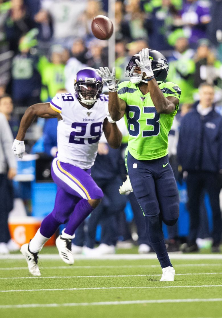 Seattle Seahawks wide receiver David Moore (83) hauls in a 60-yard touchdown catch during the third quarter as the Seahawks play the Minnesota Vikings at CenturyLink Field in Seattle on Dec. 2, 2019. Vikings cornerback Xavier Rhodes (29) defends the play. (Mike Siegel / The Seattle Times)