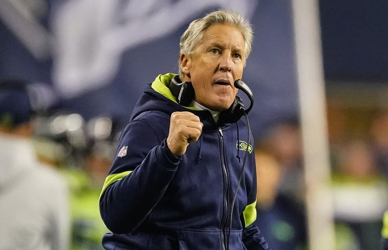 Pete Carroll pumps his fist after Rashaad Penny scores in the 4th.  The Minnesota Vikings played the Seattle Seahawks in Monday Night Football December 2, 2019 at CenturyLink Field in Seattle, WA.  (Dean Rutz / The Seattle Times)