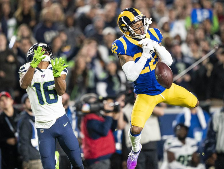 Cornerback Troy Hill steps in front of the pass intended for Tyler Lockett in the final minute of the first half, but can't seal the interception.  The Seattle Seahawks played the Los Angeles Rams in NFL football Sunday, December 8, 2019 at L.A. Memorial Coliseum. 212327 (Dean Rutz / The Seattle Times)