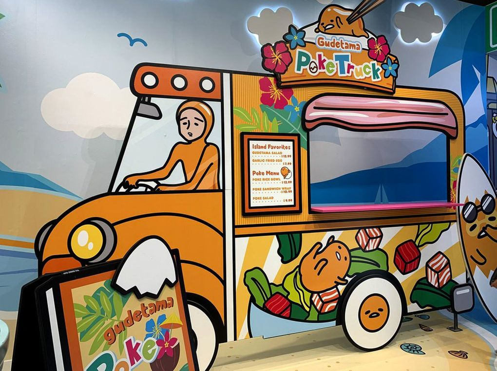 Visitors could pose in the window of fellow Sanrio character Gudetama's poké truck. (Yasmeen Wafai / The Seattle Times)