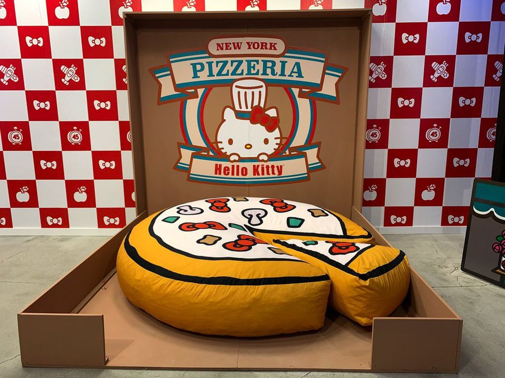 This giant stuffed pizza at the New York stop was just asking to be posed with.  (Yasmeen Wafai / The Seattle Times)