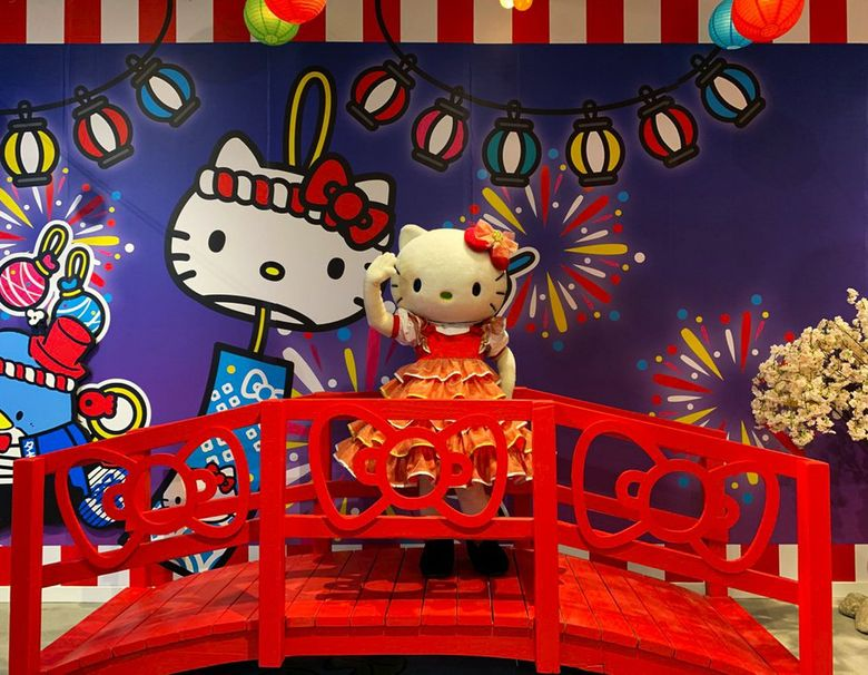 Hello Kitty herself poses on a bridge at the Tokyo stop.   (Yasmeen Wafai / The Seattle Times)