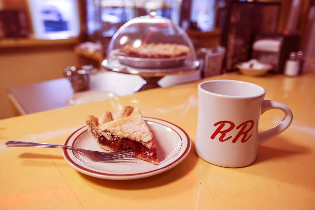 A slice of cherry pie and a cup of coffee are a common trope on Lynch's series. The text on the coffee cup is a reference to the Double R Diner, in reality North Bend's Mar-T —then Twede's —Cafe.  (Patrick Wymore / Courtesy of Showtime)