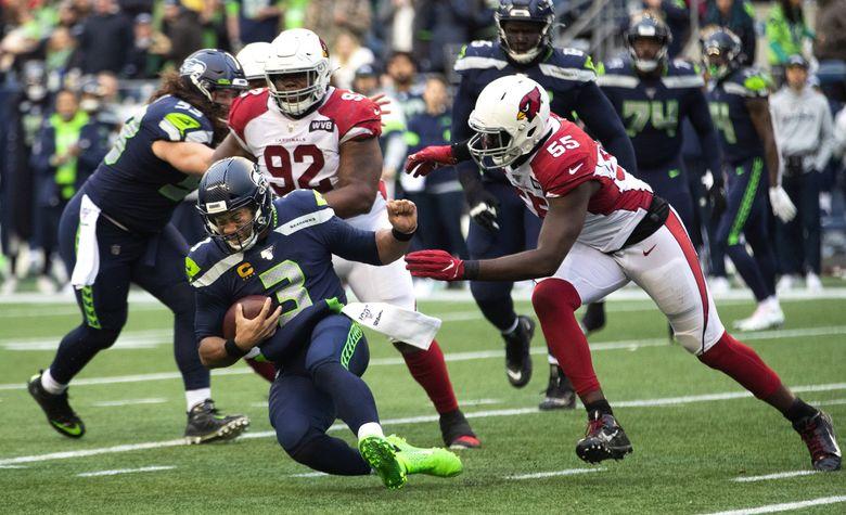 Seattle Seahawks quarterback Russell Wilson is sacked by Arizona Cardinals linebacker Chandler Jones. (Mike Siegel / The Seattle Times)