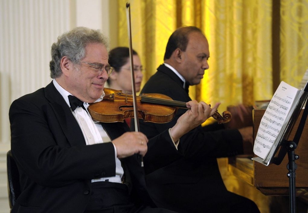 Violinist Itzhak Perlman, shown here in a 2012 performance at the White House, comes to Benaroya Hall on Jan. 15. (Susan Walsh / AP)