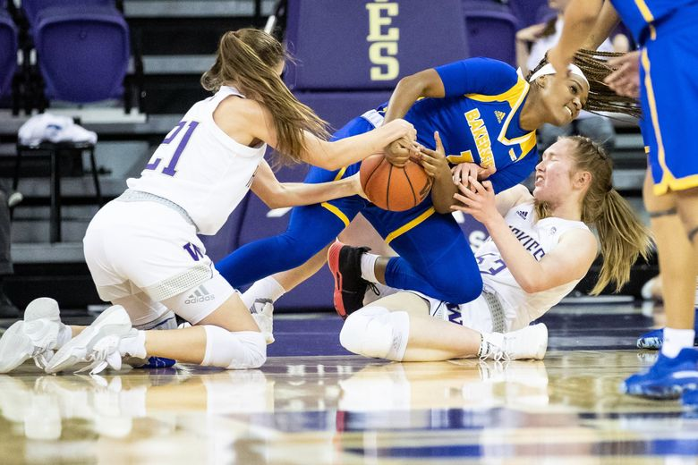 Washington Huskies guard Rita Pleskevich (21), CSU Bakersfield Roadrunners guard Daije Harris (1) and center Darcy Rees (53) fight for the ball during the women's basketball game between University of Washington and Cal State Bakersfield at Alaska Airlines Arena in Seattle on Nov. 8, 2019. (Andy Bao / The Seattle Times)