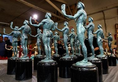 The finished statuettes are shown to the media in Burbank. The Actor stands on a base of polished black granite and weighs 12 pounds.