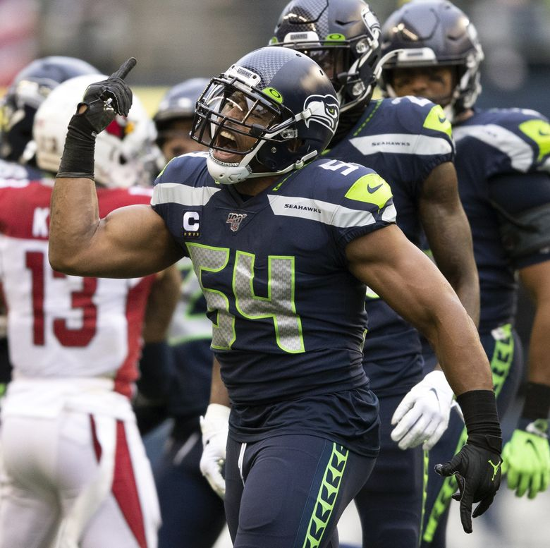 Seattle Seahawks middle linebacker Bobby Wagner (54) celebrates after tackling Arizona Cardinals wide receiver Pharoh Cooper (12) in the first half on Sunday, Dec. 22, 2019 at CenturyLink Field, in Seattle, Wash.