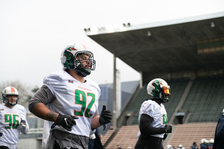 Former Husky and Seahawk defensive lineman Tani Tupou jogs out during a practice with the Seattle Dragons at Memorial Stadium. (Jane Gershovich / Courtesy Seattle Dragons)