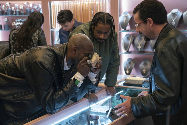 """From left, Kevin Garnett, Lakeith Stanfield and Adam Sandler star in """"Uncut Gems,"""" out Christmas Day. (A24 / Wally McGrady / The Associated Press)"""