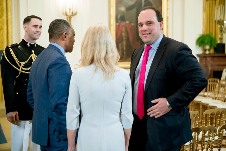 FILE – This April 1, 2019 file photo shows Boris Epshteyn, former special assistant to President Donald Trump, right, at the 2019 Prison Reform Summit and First Step Act Celebration in the East Room of the White House in Washington. The Sinclair group of local television stations said Wednesday, Dec. 11, it is dropping its commentary segments featuring Epshteyn in favor of a greater emphasis on local investigative journalism. (AP Photo/Andrew Harnik, File)