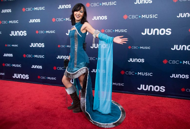 """FILE – In this March 25, 2018, file photo, Kelly Fraser arrives on the red carpet at the Juno Awards in Vancouver, British Columbia. Fraser, a Canadian pop artist who gained attention for an Inuit-language cover of Rihanna's """"Diamonds,"""" part of her advocacy efforts for her indigenous culture, has died. Fraser was 26. Thor Simonsen, Fraser's friend and producer, said he was told the day after Christmas by the singer-songwriter's family that she had died. The family declined to release details, including the cause of death, Simonsen said Saturday, Dec. 28, 2019. (Darryl Dyck/The Canadian Press via AP)"""