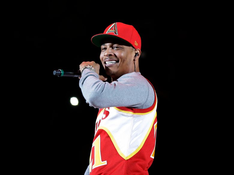 FILE – In this Nov. 1, 2014, file photo, rapper T.I. performs before the start of an NBA basketball game between the Indiana Pacers and the Atlanta Hawks in Atlanta. A New York lawmaker wants to ban tests aimed at determining virginity in response to remarks by the rapper earlier this month in which he said he has a gynecologist check his daughter's hymen annually. (AP Photo/David Goldman, File)