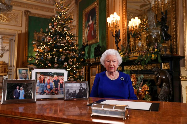 In this image released Tuesday Dec. 24, 2019, Britain's Queen Elizabeth II poses for a photo, while recording her annual Christmas Day message to the nation, at Windsor Castle, England.  Excerpts released by Buckingham Palace of the pre-recorded message to be broadcast on TV on Christmas Day, show the Queen acknowledging that both Britain and her family have endured a difficult year. (Steve Parsons/pool via AP)